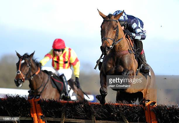 Richard Johnson riding Ballytober clear the last to win the Fernham Homes 'NAtional Hunt' Maiden Hurdle Race at Ascot racecourse on December 21 2012...