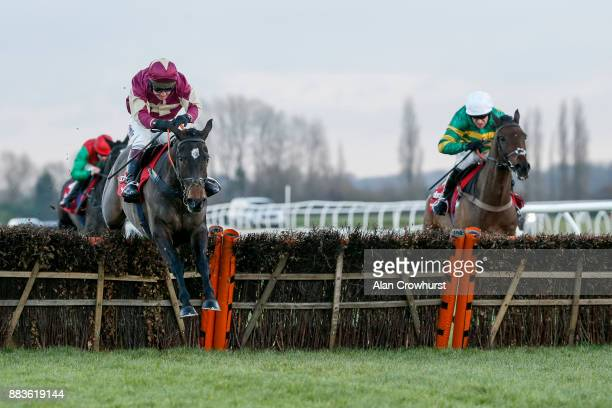 Richard Johnson riding Beer Goggles clear the last to win The Ladbrokes Long Distance Hurdle Race at Newbury racecourse on December 1 2017 in Newbury...