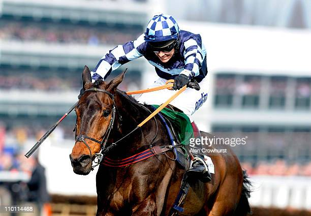 Richard Johnson riding Captain Chris wins The Irish Independent Arkle Challenge Trophy Chase at Cheltenham racecourse on Centenary Day on March 15...