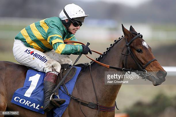 Richard Johnson riding Defi Du Seuil clear the last to win The coralcouk Future Champions Finale Juvenile Hurdle Race at Chepstow Racecourse on...