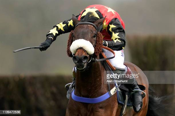 Richard Johnson riding En Meme Temps clear the last to win The Your Bet With Ascot Means More Maiden Hurdle at Ascot Racecourse on March 31 2019 in...