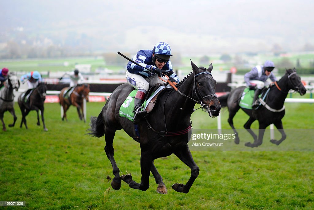 Richard Johnson riding Garde La Victoire clear the last to win The stanjames.com Greatwood Hurdle Race at Cheltenham racecourse on November 16, 2014 in Cheltenham, England.