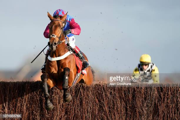 Richard Johnson riding La Bague Au Roi clear the last to win The Ladbrokes Novices' Chase at Newbury Racecourse on November 30 2018 in Newbury England