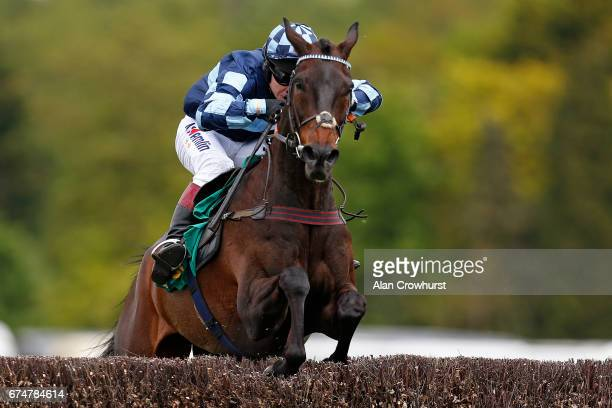 Richard Johnson riding Menorah clear the last to win The bet365 Oaksey Steeple Chase at Sandown Park on April 29 2017 in Esher England