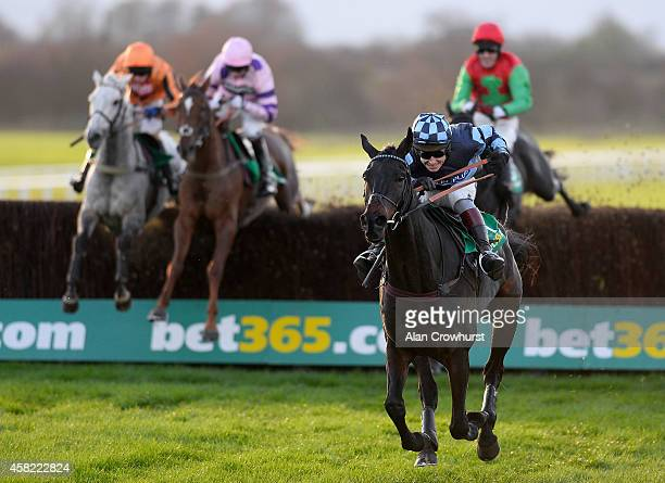 Richard Johnson riding Menorah clear the last to win The bet365 Charlie Hall Steeple Chase at Wetherby racecourse on Novemeber 01 2014 in Wetherby...