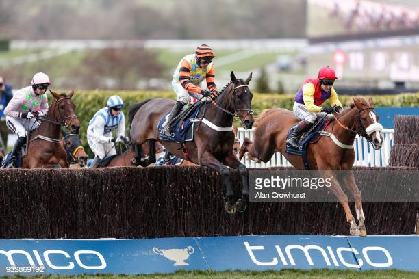 Richard Johnson riding Native River clear the second fence before going on to win The Timico Cheltenham Gold Cup Steeple Chase from Might Bite at...