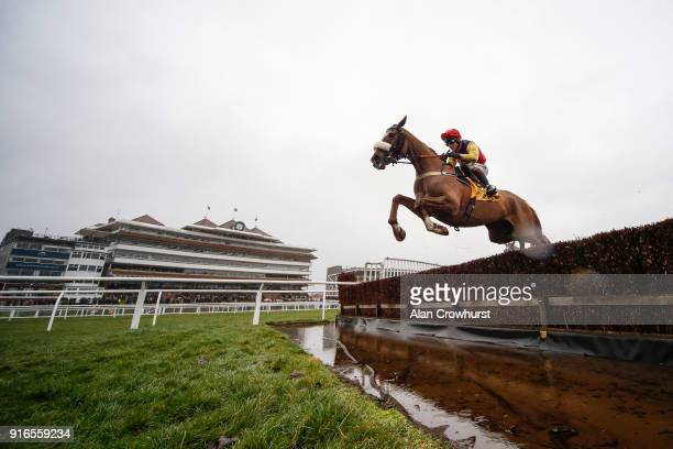 Richard Johnson riding Native River clear the water jump before winning The Betfair Denman Steeple Chase at Newbury racecourse on February 10 2018 in...