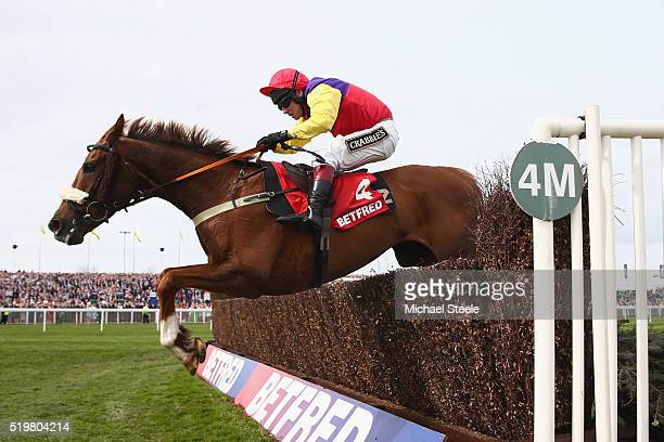 Richard Johnson riding Native River clears the last on his way to victory in the Betfred Mildmay Novices' steeplechase at Aintree Racecourse on April...