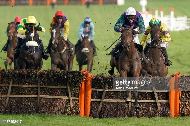 Richard Johnson riding Thyme Hill clear the last to win The Ballymore Novices' Hurdle at Cheltenham Racecourse on November 16, 2019 in Cheltenham,...