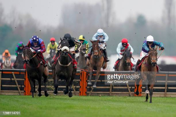 Richard Johnson riding Thyme Hill clear the last to win The Ladbrokes Long Distance Hurdle at Newbury Racecourse on November 27, 2020 in Newbury,...