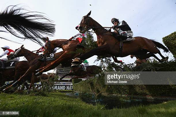 Richard Johnson riding Village Vic clears the water jump in the Crabbie's Topham Steeple Chase at Aintree Racecourse on April 8 2016 in Liverpool...