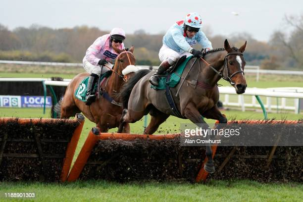 Richard Johnson riding Winter Getaway clear the last to win The Use The racingtvcom Tracker Mares' Novices' Hurdle at Warwick Racecourse on November...