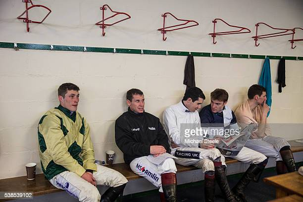 Richard Johnson watches television in the changing rooms alongside fellow jockeys Ian Popham Aidan Coleman Tom Scudamore and James Best at Exeter...