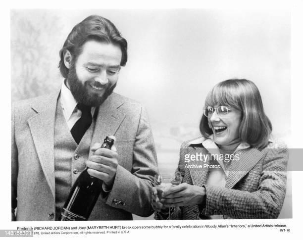 Richard Jordan and Marybeth Hurt open champagne for a family celebration in a scene from the film 'Interiors' 1978