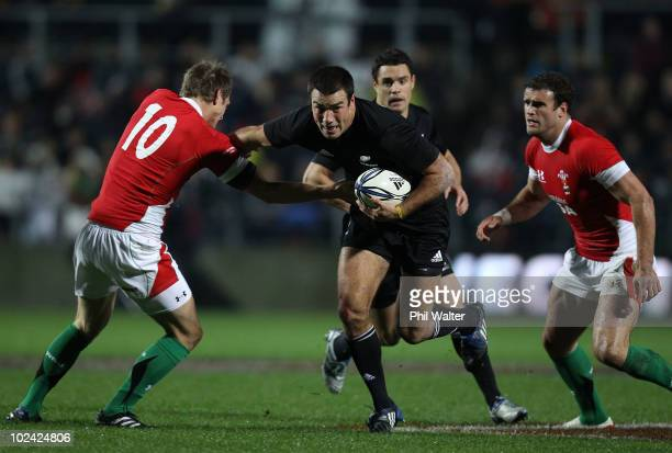 Richard Kahui of the All Blacks fends off Dan Biggar of Wales during the rugby test match between the New Zealand All Blacks and Wales at Waikato...