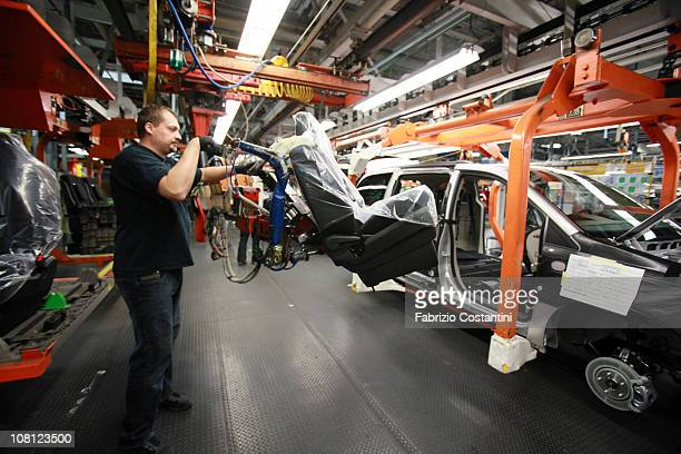 Richard Kailer installs a seat in a Chrysler Minivan on the assembly line at the Chrysler Windsor Assembly plant January 18 2011 in Windsor Ontario...