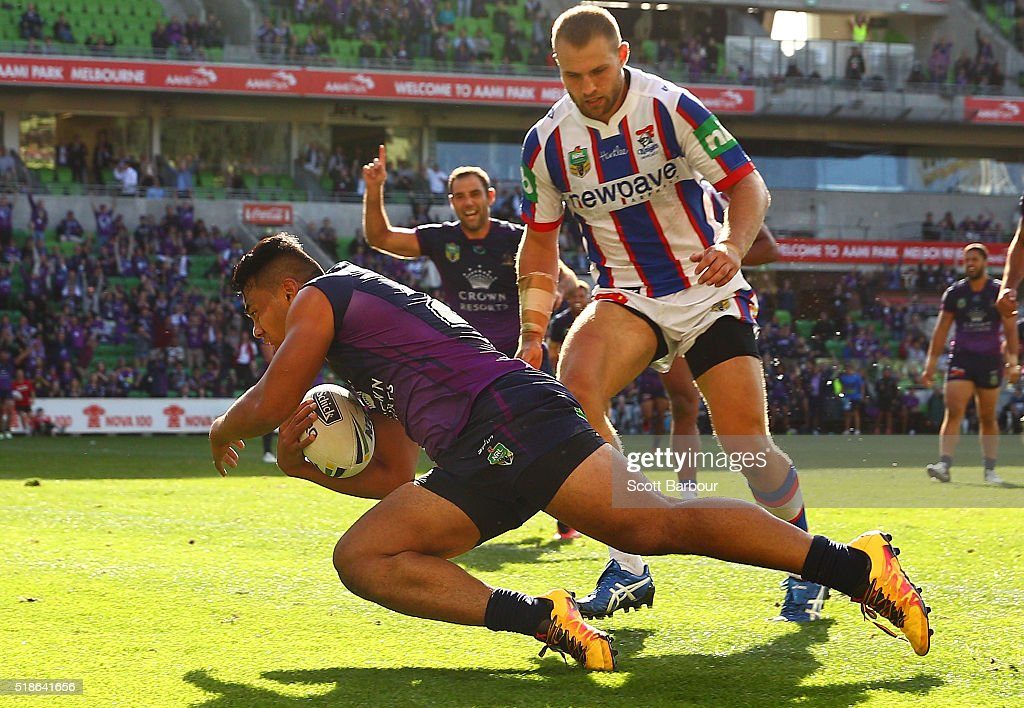Richard Kennar of the Storm scores the match winning try as Cameron Smith celebrates during the round five NRL match between the Melbourne Storm and the Newcastle Knights at AAMI Park on April 2, 2016 in Melbourne, Australia.