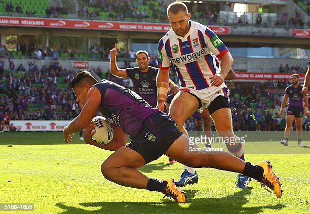 Richard Kennar of the Storm scores the match winning try as Cameron Smith celebrates during the round five NRL match between the Melbourne Storm and...