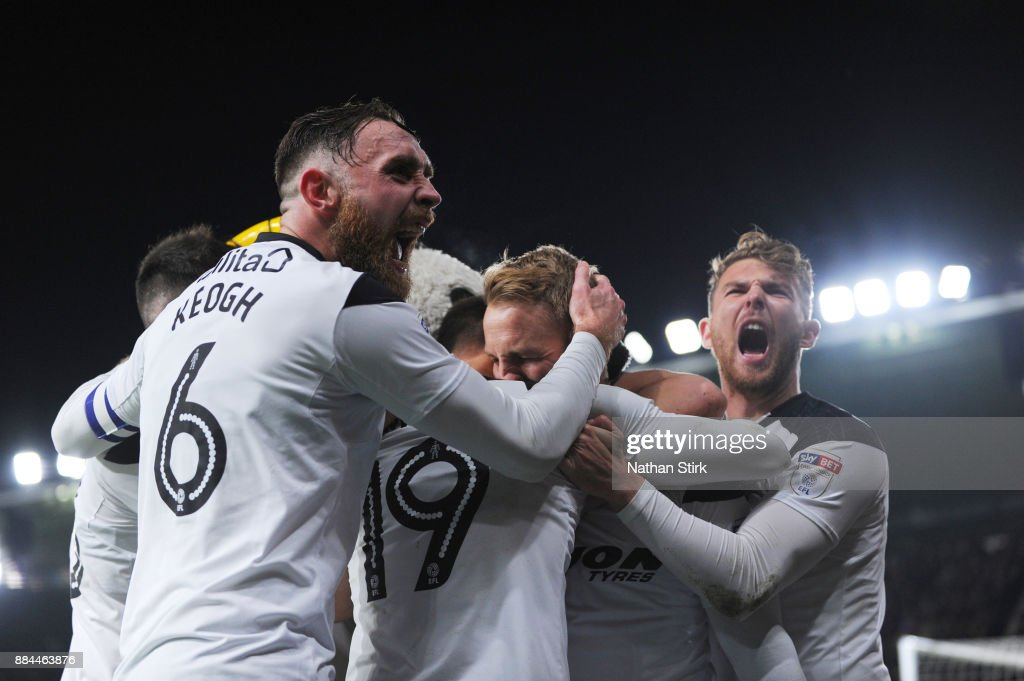 Richard Keogh (L) and Sam Winnall (R) of Derby County celebrates with Johnny Russell after he scores the winning goal during the Sky Bet Championship match between Derby County and Burton Albion at iPro Stadium on December 2, 2017 in Derby, England.
