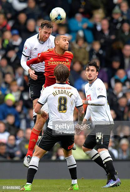 Richard Keogh of Derby County and Dexter Blackstock of Nottingham Forest compete for the ball during the Sky Bet Championship match between Derby...