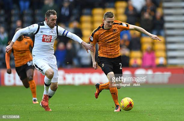 Richard Keogh of Derby County and Jon Dadi Bodvarsson of Wolverhampton Wanderers during the Sky Bet Championship match between Wolverhampton...