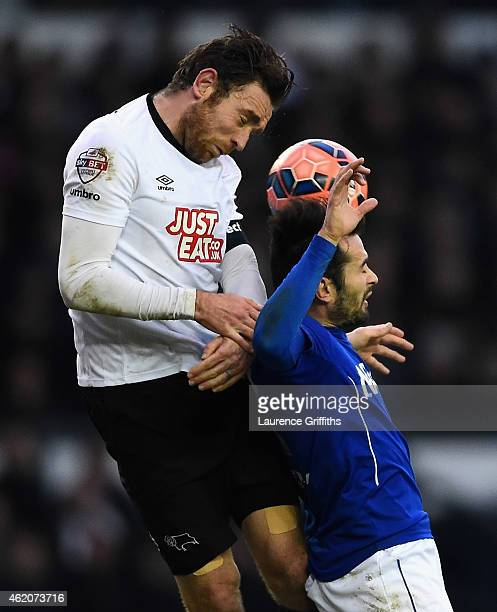 Richard Keogh of Derby County battles with Sam Hird of Chesterfield during the FA Cup Fourth Round match between Derby County and Chesterfield at...