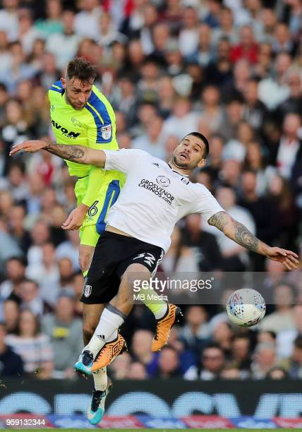 Richard keogh of Derby County gets to a header before Fulham's Aleksandar Mitrovic during the Sky Bet Championship Play Off Semi Final Second Leg on...