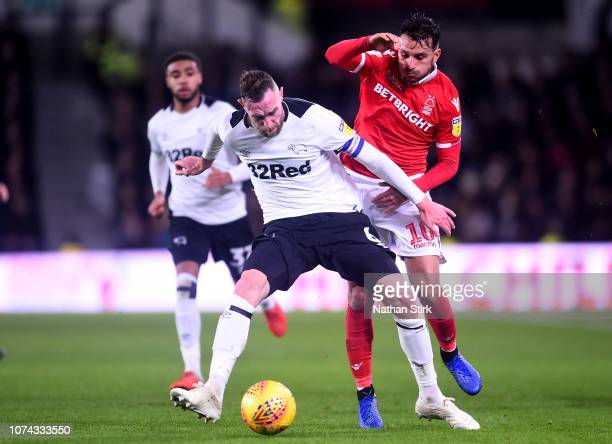 Richard Keogh of Derby County is challenged by Joao Carvalho of Nottingham Forest during the Sky Bet Championship match between Derby County and...