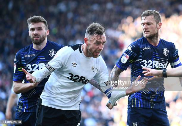 Richard Keogh of Derby County reacts with Liam Cooper and Stuart Dallas of Leeds United during the Sky Bet Championship PlayOff Semi Final First Leg...