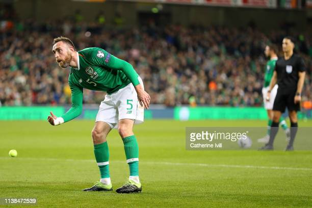 Richard Keogh of Ireland removes a tennis ball thrown onto the pitch in protest at FAI Executive Vice President John Delaney during the 2020 UEFA...