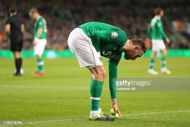 Richard Keogh of Ireland removes tennis balls thrown onto the pitch in protest at FAI Executive Vice President John Delaney during the 2020 UEFA...