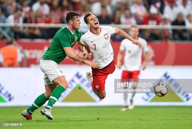 Richard Keogh of Republic of Ireland tackles Arkadiusz Milik of Poland during the International Friendly match between Poland and Republic of Ireland...