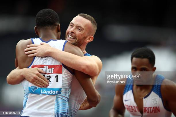 Richard Kilty of Great Britain celebrates with team mate Zharnel Hughes after winning the Men's 4x100m Relay during Day Two of the Muller Anniversary...