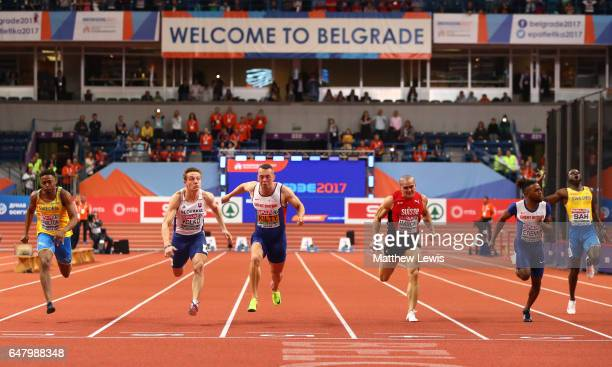 Richard Kilty of Great Britain crosses the finish line ahead of Jan Volko of Slovakia to win the gold medal on day two of the 2017 European Athletics...