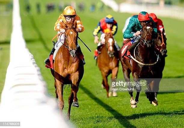 Richard Kingscote riding Pyman's Theory win The Piper Heidsieck Champagne National Stakes at Sandown racecourse on May 26, 2011 in Esher, England.