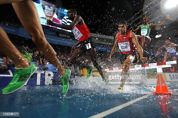 Richard Kipkemboi Mateelong of Kenya, Hamid Ezzine of Morocco and Roba Gari of Ethiopia compete in the men's 3000 metres steeplechase final during...