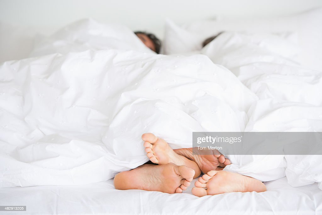 Richard & Kirstin bed feet -009 : Stock Photo