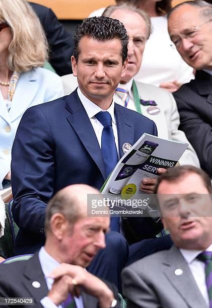 Richard Krajicek arrives to take his seat in the Royal Box on Centre Court before the Gentlemen's Singles quarter-final match between David Ferrer of...