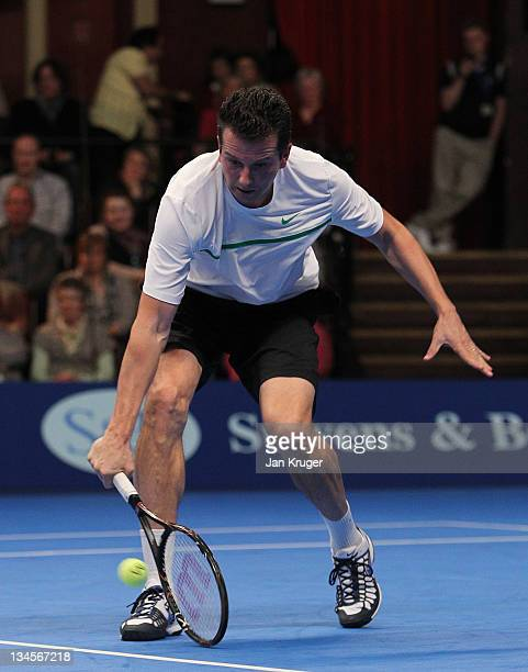 Richard Krajicek of Netherlands in action against John McEnroe of the USA on Day Three of the AEGON Masters Tennis at the Royal Albert Hall on...