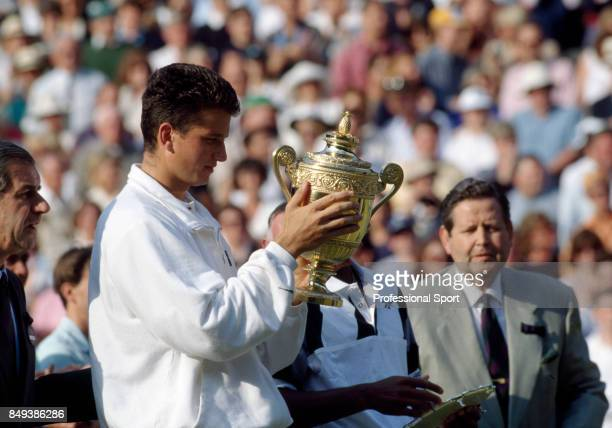 Richard Krajicek of the Netherlands holds the trophy after his straight-sets victory over MaliVai Washington of the USA in the men's singles final...