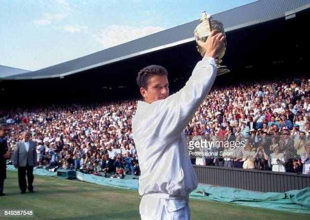 Richard Krajicek of the Netherlands holds the trophy aloft after his straight-sets victory over MaliVai Washington of the USA in the men's singles...