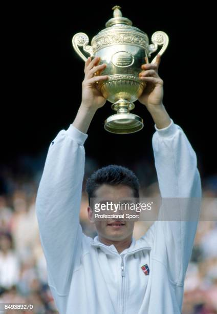 Richard Krajicek of the Netherlands kisses the trophy after his straight-sets victory over MaliVai Washington of the USA in the men's singles final...