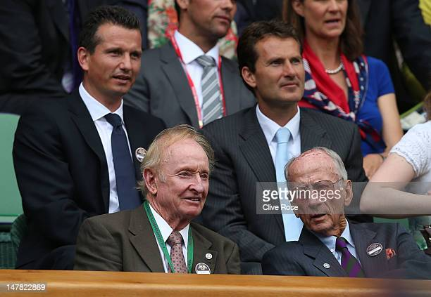 Richard Krajicek, Rod Laver and Jacco Eltingh look on from the Royal Box on Centre Court on day nine of the Wimbledon Lawn Tennis Championships at...