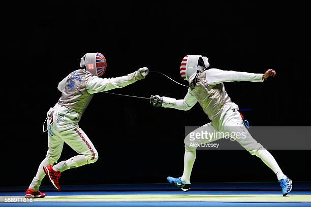 Richard Kruse of Great Britain competes against Gerek Meinhardt of the United States during Men's Individual Foil Quarter Finals on Day 2 of the Rio...