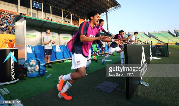 Richard Ledezma of the United States and team mates celebrate victory after the 2019 FIFA U-20 World Cup Round of 16 match between France and USA at...