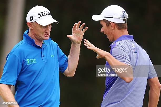 Richard Lee of New Zealand and Australian react together after both making birdies on the 16th green during day three of the Australian Masters at...