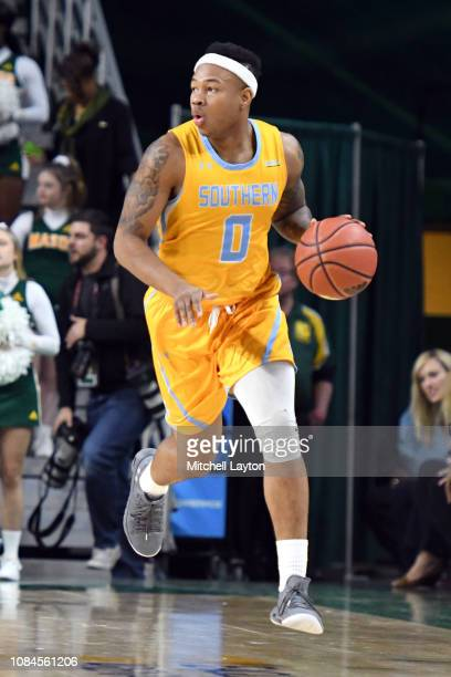 Richard Lee of the Southern University Jaguars dribbles up court during a college basketball game against the George Mason Patriots at the Eagle Bank...