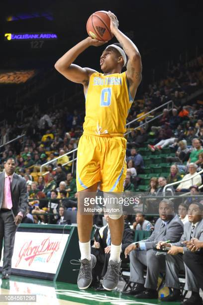 Richard Lee of the Southern University Jaguars takes a jump shot during a college basketball game against the George Mason Patriots at the Eagle Bank...