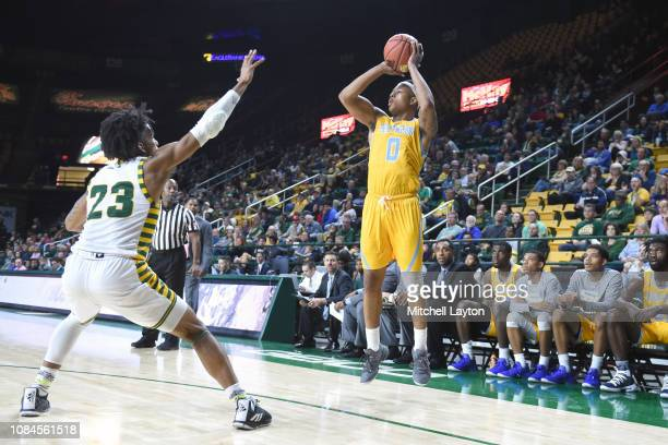 Richard Lee of the Southern University Jaguars takes a shot over Javon Greene of the George Mason Patriots during a college basketball game at the...