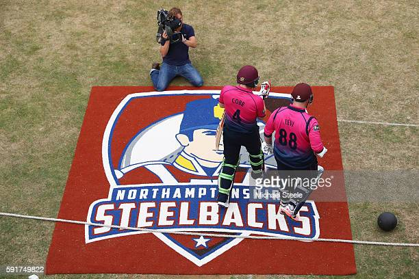 Richard Levi and Josh Cobb of Northants head out to open the batting during the Royal London OneDay Cup Quarter Final match between Northamptonshire...